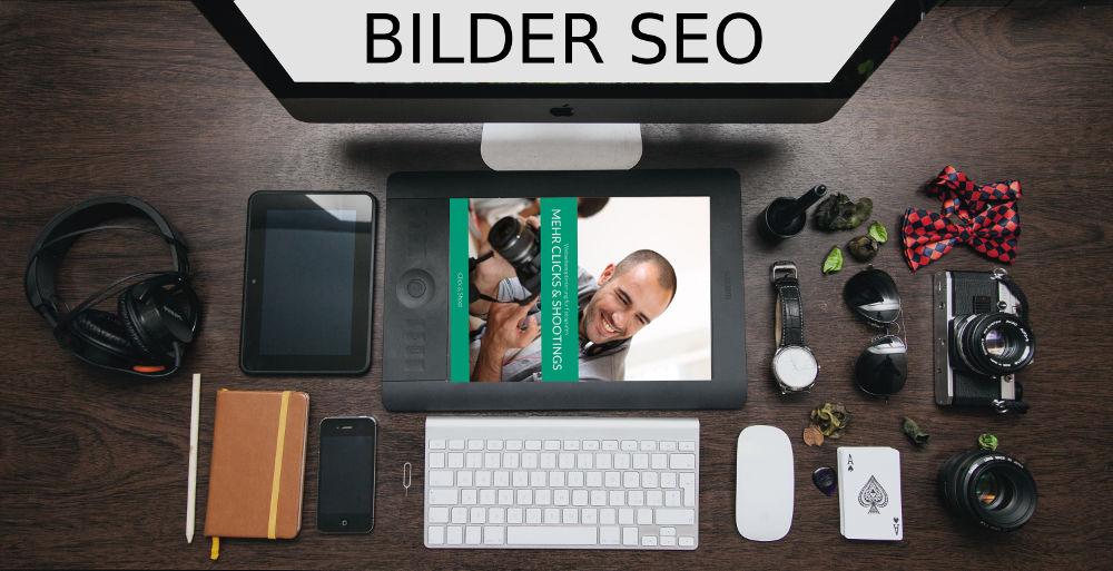"""Schreibtisch voll mit technischem Zubehör inkl. Monitor mit dem Schriftzug """"Bilder SEO"""""""